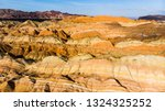 rainbow mountains geological... | Shutterstock . vector #1324325252