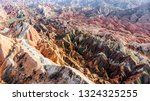 top view of rainbow mountains... | Shutterstock . vector #1324325255