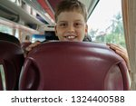 8 year old boy travels by bus | Shutterstock . vector #1324400588