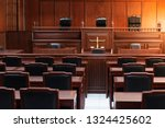 Small photo of Red wood table and red chair in the justice court