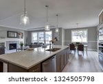 Small photo of Gig Harbor, WA / USA - Feb. 24, 2019: Luxury kitchen, living room, and dining room interior
