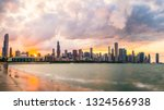 Chicago skyline at sunset with cloudy sky and reflection in water,chicago,illinois,usa. - stock photo