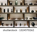 a wooden shelves full with... | Shutterstock . vector #1324570262