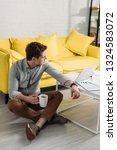 tired man in glasses sitting on ...   Shutterstock . vector #1324583072