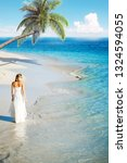 bride on the coast of a... | Shutterstock . vector #1324594055