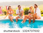 group of friends at a poolside... | Shutterstock . vector #1324737032