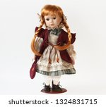 Small photo of Porcelain Doll with Long Hair. Handmade Clothing for Dolls.
