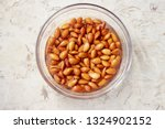 Small photo of Soaking almonds in water. Almonds being softened in water to create almond milk.
