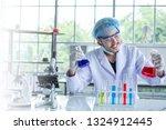 male scientist testing an... | Shutterstock . vector #1324912445