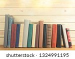 ancient books in a row on... | Shutterstock . vector #1324991195