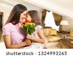 portrait of happy mother and... | Shutterstock . vector #1324993265