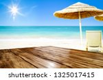desk of free space and beach... | Shutterstock . vector #1325017415