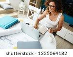female freelancer working at... | Shutterstock . vector #1325064182