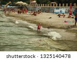 people are resting on the... | Shutterstock . vector #1325140478
