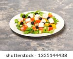 geek salad on table with freesh ... | Shutterstock . vector #1325144438