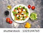 greek salad with ingredients on ... | Shutterstock . vector #1325144765
