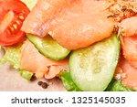 salmon with fresh vegetables.... | Shutterstock . vector #1325145035