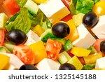 greek salad with fresh... | Shutterstock . vector #1325145188