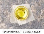 oil on backgroun in glass bowl. ... | Shutterstock . vector #1325145665