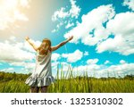 young beautiful woman on green... | Shutterstock . vector #1325310302