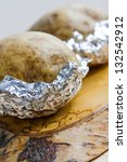 fresh baked potatoe with sour...