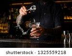 bartender adding to an... | Shutterstock . vector #1325559218