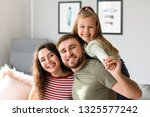 portrait of happy family at home   Shutterstock . vector #1325577242