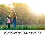 back view of young slim... | Shutterstock . vector #1325599745