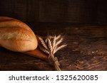 fresh homemade bread. crisp.... | Shutterstock . vector #1325620085