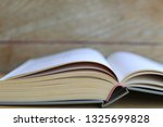 close up of books open on... | Shutterstock . vector #1325699828