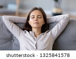 peaceful young woman with hands ... | Shutterstock . vector #1325841578