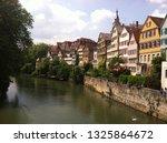 buildings on the neckar river... | Shutterstock . vector #1325864672
