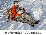 young man playing with husky... | Shutterstock . vector #132586892