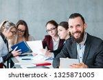 idle employee. team member... | Shutterstock . vector #1325871005