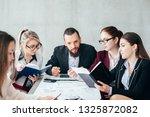 business team meeting. money... | Shutterstock . vector #1325872082