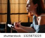 female artist sketching.... | Shutterstock . vector #1325873225