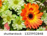 bouquet of white and orange... | Shutterstock . vector #1325952848
