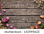 Stock photo abstract holiday frame with rose petals and dried flowers on old wooden plates 132595622