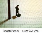 man and pillar to wait | Shutterstock . vector #1325961998
