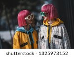 Small photo of Milan, Italy - February 20, 2019: Street style outfits - Ami Suzuki and Aya Suzuki before a fashion show during Milan Fashion Week - MFWFW19