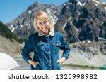beautiful young girl posing at...   Shutterstock . vector #1325998982