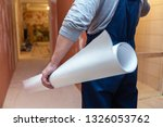 worker is holding the white... | Shutterstock . vector #1326053762