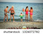 people are resting on the... | Shutterstock . vector #1326072782
