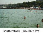 people are resting on the... | Shutterstock . vector #1326074495