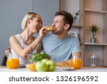 young laughing girl feeding... | Shutterstock . vector #1326196592