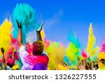 crowd throws colored powder at... | Shutterstock . vector #1326227555