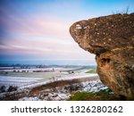 boulder and landscape in winter | Shutterstock . vector #1326280262