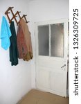 a door and some cloths in a... | Shutterstock . vector #1326309725