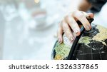 woman touching a desk globe ball | Shutterstock . vector #1326337865