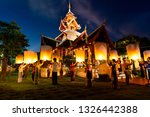 Small photo of Yi Peng, Loy Kratong Festival and lantern lift off. People making a pray and launching paper lantern lift off to night sky at Chiang Mai province, Thailand